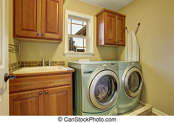 simple laundry room with tile floor.