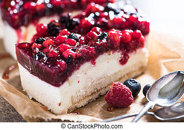 Simple mascarpone cheesecake with winter berry forest fruits, serving slices