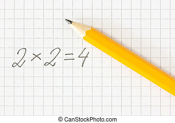 Simple math formula and pencil on squared paper
