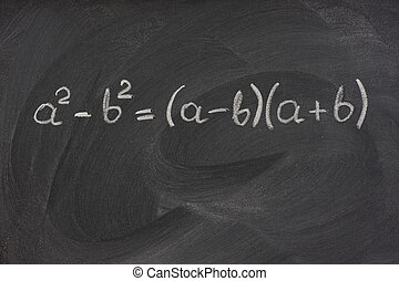 simple mathematical formula handwritten with white chalk on a blackboard with strong eraser smudge patterns