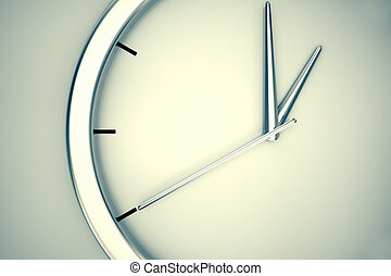 Closeup on a simple modern clock hanging on a wall on a bright background. May represent passage or shortage of time, house or office decorations.