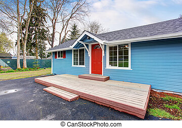Simple one story house exterior with blue and red trim