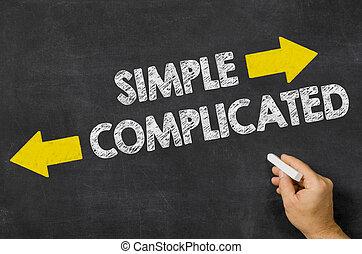 Simple or Complicated written on a blackboard