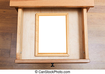 simple picture frame in open drawer