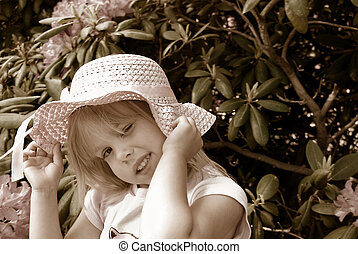Simple Pleasure - Little girl with hat in sepia tones.