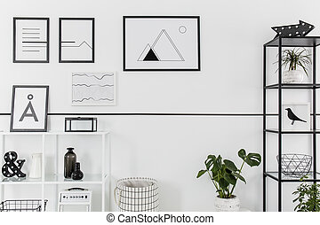 Simple posters on white wall