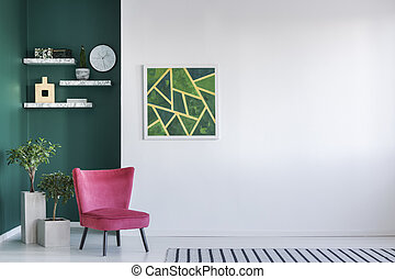 Simple room with red armchair, abstract painting and clock ...