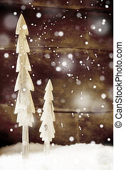 Simple rustic Christmas trees in snow