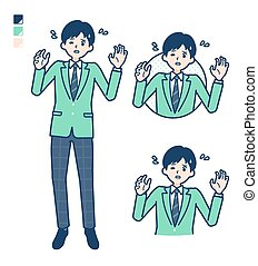 A student boy in a green blazer with panic images.