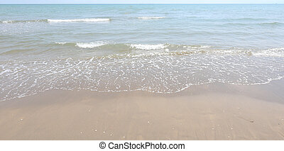 simple sea background with sandy beach in summer without people