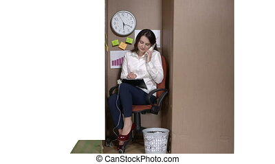 Business woman on the phone in a cardboard box working with documents