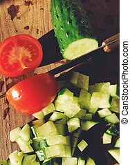 Simple spring green salad with cucumber and tomato