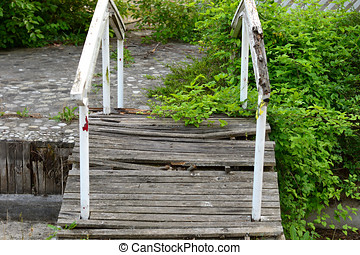 Simple still-life photo of old broken bridge in the garden