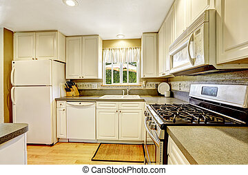 Simple white kitchen with granite tops