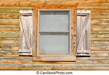 Simple window on wooden wall