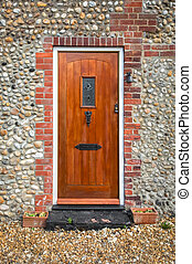 wooden front door - simple wooden front door set in a...
