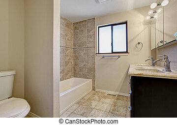 Simple yet elegant bathroom with nice bathtub and tile floor.