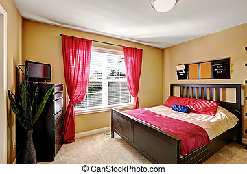 Simple yet practical bedroom design with dark brown bed, dresser and red decorative elements to enhance brightness of the room