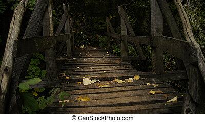 Simplicity - Yellow fallen leaves on a wooden bridge