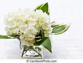 Simplicity offered in simple, white flower arrangement