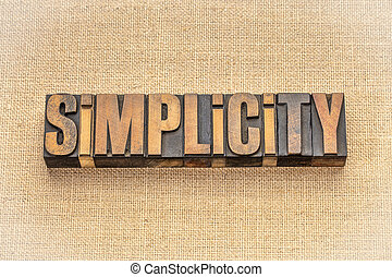 simplicity word abstract in wood type