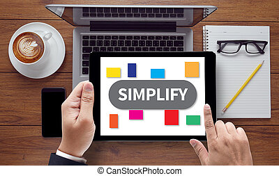 SIMPLIFY, on the tablet pc screen held by businessman hands...