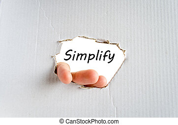 Simplify - Hand and text Simplify on the cardboard...