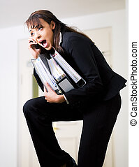 Simultaneous - Female office worker being barely able to do...