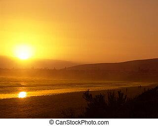 sinaasappel, strand, ondergaande zon