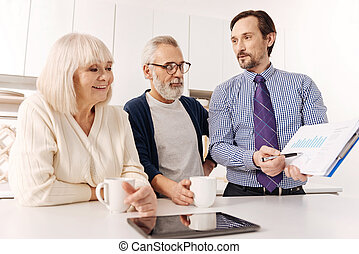 Sincere realtor discussing contract issues with future owners of house