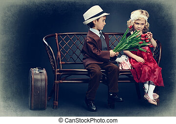 sincerity - Cute little boy is giving bouquet of tulips to...