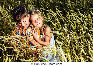 sincerity - Happy children in the wheat field on a bright...