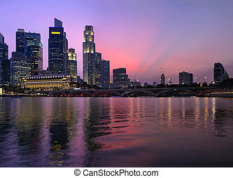 Singapore Central Business District Skyline Along River and Esplanade Bridge at Twilight