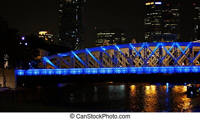 Beautiful, lighted bridge over the Singapore River at night