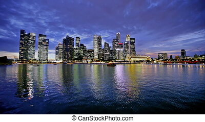 Singapore city skyline at night wit