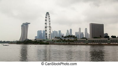 Singapore cityview with Ferris wheel cloudiness time-lapse