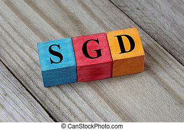 Singapore Dollar sign on colorful wooden cubes