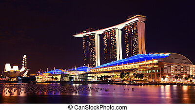 Marina bay sands with sky park towers by night. Nightlife scene asia.