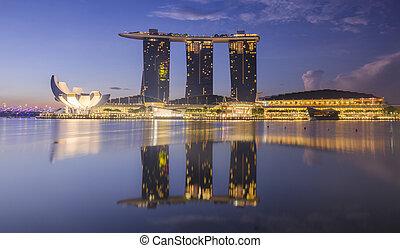 SINGAPORE -May 13: Wonderful sunrise at the Marina Bay waterfront in Singapore. Marina Bay Sands Hotel dominates the skyline at Marina Bay on May 13, 2014.