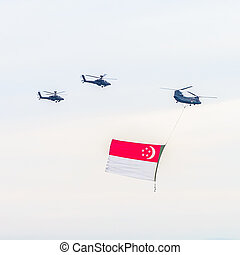 Singapore national day with helicopter and singapore flag on...