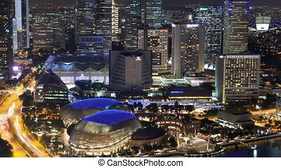 Singapore night cityscape with Theatres time-lapse. pan up