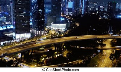 Singapore night view from the top on the road with moving...