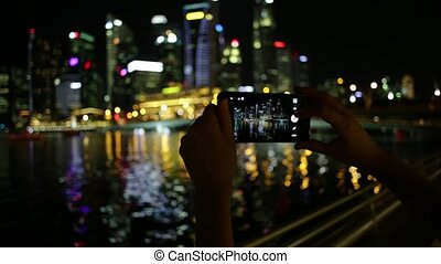 Singapore phone photo - View of woman's hands taking photo...