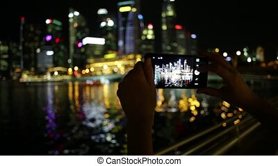 Singapore phone picture - hands taking pictures by mobile...