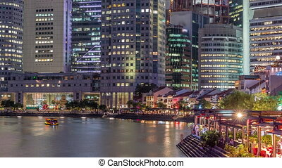 Singapore quay with tall skyscrapers in the central business district on Boat Quay day to night timelapse