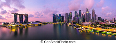 Singapore, Singapore – July 2016 : Aerial view of Singapore city skyline in sunrise or sunset at Marina Bay, Singapore