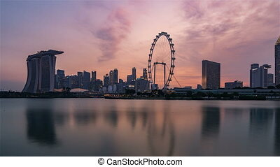 Singapore, Singapore, Timelapse - The Singaporean skyline and its iconic wheel from Day to Night