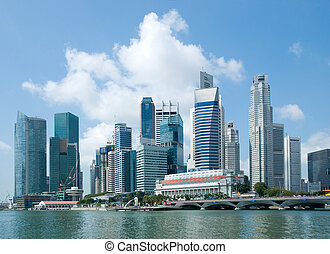 The skyline of Singapore financial district as seen from Esplanade, with Merlion, the fish lion sculpture, visible in the foreground.