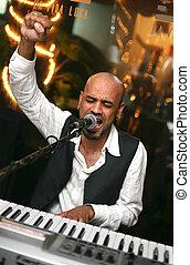 "Singer at an alive concert in a night club \\\""La vida..."