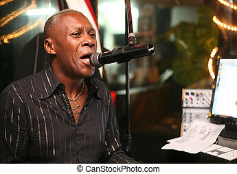 "Singer at an alive concert in a night club ""La vida loka"". ..."